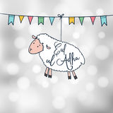 Eid-ul-Adha greeting card with hand drawn sheep and party flags. Muslim community festival of sacrifice. Modern blurred. Eid-ul-Adha greeting card with hand Royalty Free Stock Photo