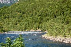 Eidfjord and rapid river in Norway.  Stock Photography