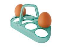 Eier auf dem Stand lokalisiert auf weißem Hintergrund Stockfotografie