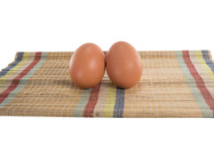 Eier auf der Matte Stockbild