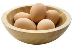 Eier in der hölzernen Schüssel Lizenzfreies Stockbild