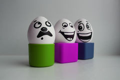 Eier mit einem netten Gesicht Lizenzfreie Stockfotografie