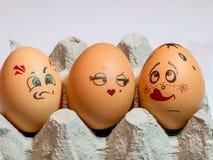 Eier mit gemalten Gesichtern Foto für Ihr Design Konzept des Gelenkes Lizenzfreie Stockbilder