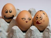 Eier mit gemalten Gesichtern Foto für Ihr Design Konzept des Gelenkes Lizenzfreie Stockfotos