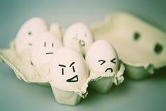 Eier mit Gesichtern Stockfotografie