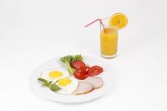 Eier und Saft Lizenzfreie Stockfotos