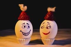 Eieren in chrismassstemming met liefde voor elkaar royalty-vrije stock foto