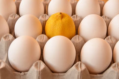 Eieren en een citroen Royalty-vrije Stock Afbeeldingen