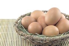 Eieren in geïsoleerdes mand Royalty-vrije Stock Fotografie