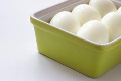 Eieren in groene container royalty-vrije stock afbeeldingen
