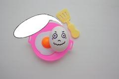 Eieren met gezicht Concept helder stock foto's