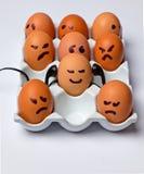 Eieren met gezichten Stock Foto's