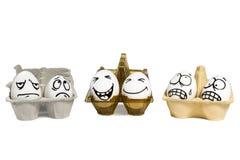 Eieren met grappig en kwade gezichten Stock Afbeelding