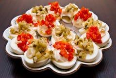 Eieren met komkommer en Spaanse peper royalty-vrije stock afbeelding