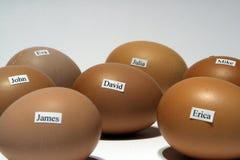 Eieren met namen Stock Fotografie