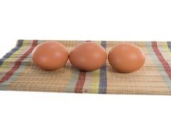 Eieren op de mat Royalty-vrije Stock Afbeeldingen