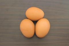 Eieren op houten Royalty-vrije Stock Afbeelding