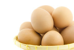 Eieren op mand Stock Afbeelding