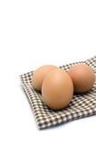 Eieren op tafelkleed Royalty-vrije Stock Foto