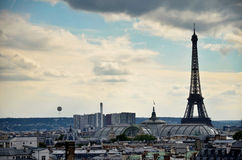 The Eiffel tour and a hot air balloon Stock Image