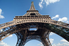 Eiffel Tower. A view from below the Eiffel Tower showing the blue sky and clouds Stock Image