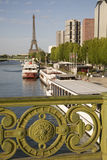 Eiffel Tower. And the banks of the River Seine, Paris, France with bridge detail in foreground Stock Photo