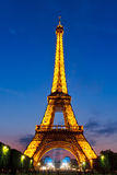 Eiffel Tower. PARIS - MAY 28, 2008: Eiffel Tower brightly illuminated at dusk on May 28, 2008 in Paris. The Eiffel tower is the most visited monument of France Stock Images