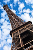 Eiffel tower. Eiffel tower tilted view over blue sky with white clouds Stock Photos