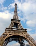 Eiffel tower. The famous Eiffel Tower in Paris, viewed from below with a nice cloudy sky Royalty Free Stock Photos