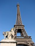 Eiffel Tower. A photograph of the Eiffel Tower with a horse statue on the foreground royalty free stock image