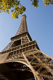 Eiffel Tower. Photo taken right at the bottom of the Eiffel Tower exaggerating the perspective Stock Image