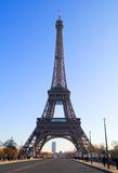 The Eiffel Tower. View from across the road bridge with tourists and other pedestrians. No recognizable faces Royalty Free Stock Photo