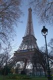 The Eiffel Tower. Picturesque view with Parisian street light stock photos