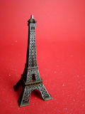 Eiffel Tower. A souvenir of Eiffel Tower on red background Royalty Free Stock Photography