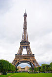 The Eiffel Tower. Is an iron tower built on the Champ de Mars beside the Seine River in Paris. The tower has become a global icon of France and is one of the Stock Image