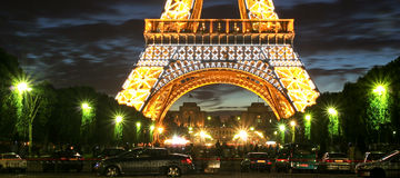 Eiffel Tower. Fragment of Eiffel Tower with night illumination in Paris, France Royalty Free Stock Photo
