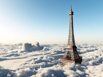 Eiffel Tower above the clouds Stock Images