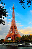 Eiffel Tower Above Seine River Against Blue Sky Royalty Free Stock Photos