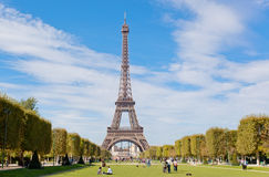 Eiffel Tower against the blue sky and clouds, Stock Images
