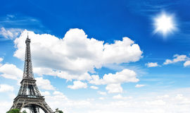 Eiffel Tower against cloudy blue sky. Eiffel Tower (La Tour Eiffel) against cloudy blue sky. Champ de Mars, place of interest in Paris, Europe Stock Photo