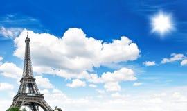 Eiffel Tower against cloudy blue sky Stock Photo