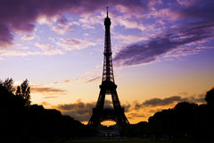 Eiffel Tower against a coloful sunset royalty free stock photo