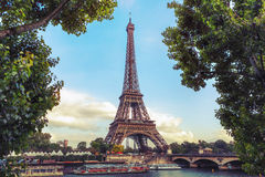 Eiffel Tower against the sky and the trees Royalty Free Stock Image
