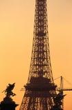 Eiffel tower and Alexander III bridge statues royalty free stock photo