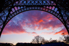 Eiffel tower arc. Red clouds through the eiffel tower arc Stock Photo