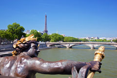 Eiffel Tower, artistic statue and bridge on Seine river in Paris, France. Royalty Free Stock Photos