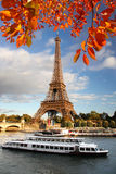 Eiffel Tower with autumn leaves in Paris, France Royalty Free Stock Photography