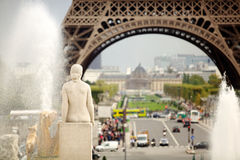 Eiffel Tower, back of a female statue Royalty Free Stock Image