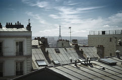 Eiffel tower behind roofs Stock Photo