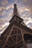 Eiffel tower from below. Against cloudy sky Stock Photo